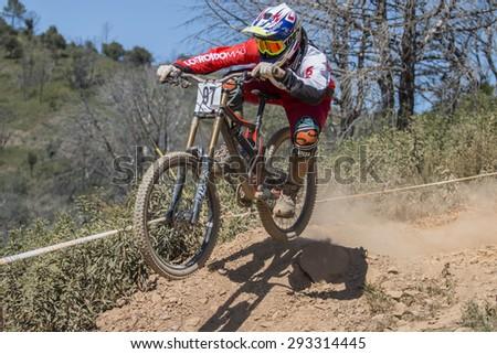PORTUGAL - SAO BRAS DE ALPORTEL, March 15th 2015: 1st stage - Portuguese Cup - Downhill competition, Biker rides fast in the countryside. - stock photo
