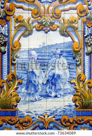 "Portugal Typical Portuguese ""azulejo"" blue and white ceramic tiles depicting agricultural workers in the Douro wine region - stock photo"
