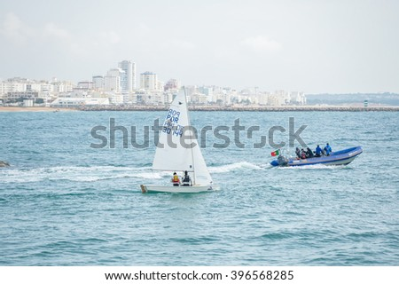 Portugal, Vilamoura - 06 February 2016: young sailors sailing during 42 th Carnival Regatta from CIMAV. Ocean outdoors background.  illustrative, editorial