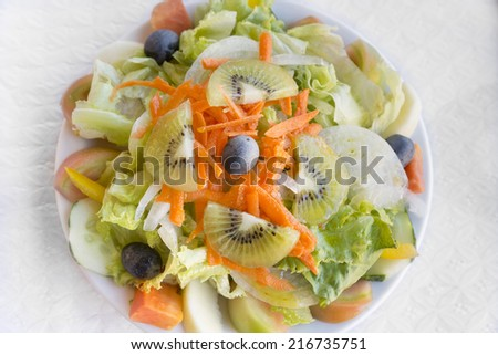 Portugese mixed salad on a plate - stock photo