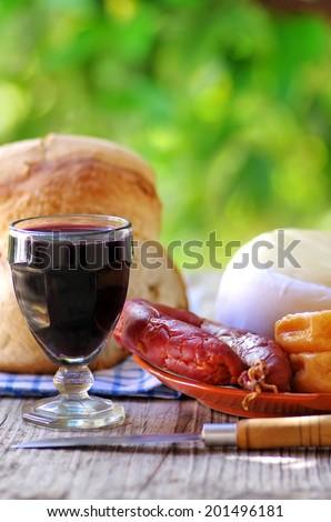 Portuguese bread, wine, cheese and chorizo - stock photo