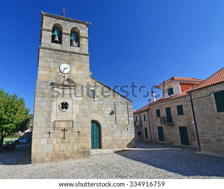 Portuguese Church and bell tower from the 17th century at Freixo do Numao near the Duro. Taken on a clear day. - stock photo