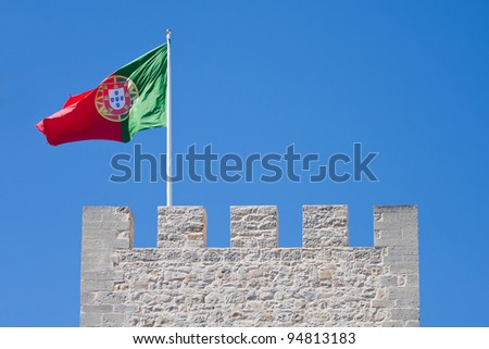 Portuguese flag on a wall of castle in Silves.