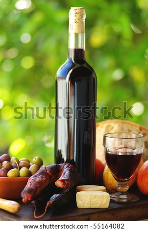 Portuguese food and red wine. - stock photo