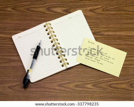 Portuguese; Learning New Language Writing Words on the Notebook - stock photo