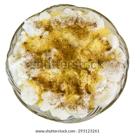 Portuguese poached meringues, also called farofias, floating on a custard cream. It is a traditional dessert made from milk, eggs and sugar. - stock photo