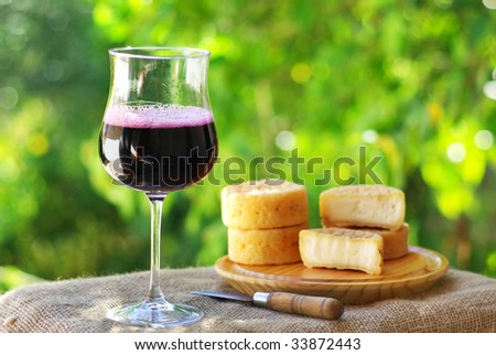 Portuguese Red wine and cheese. - stock photo