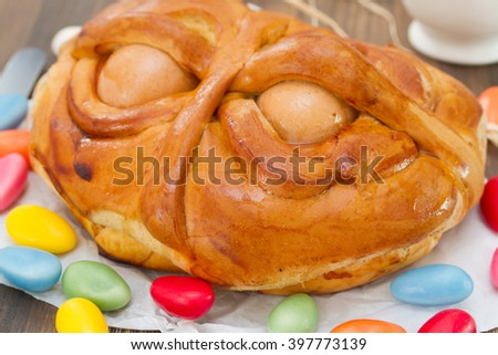 portuguese traditional Easter cake Folar on brown wooden background - stock photo