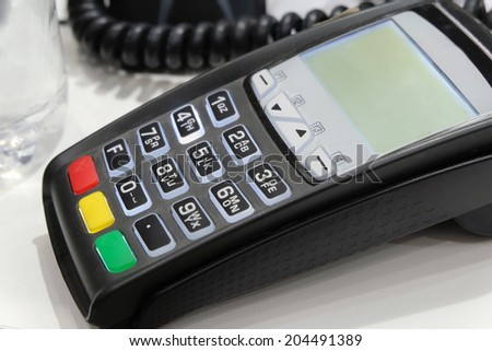 POS terminal on the table. Close-up. - stock photo