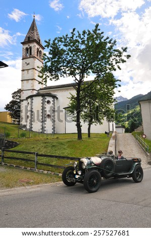 POSCHIAVO, SWITZERLAND - JUNE 13: A british racing green Bentley 3 Litre takes part to the Summer Marathon classic car race on June 13, 2014 in Poschiavo. This car was built in 1925 - stock photo
