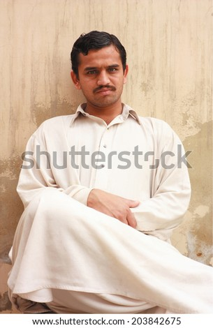 Pose of an angry Asian guy - stock photo