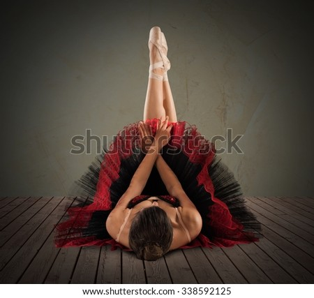 Pose of ballet dancer with legs extended - stock photo