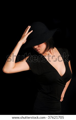 Posh Asian girl in a black hat