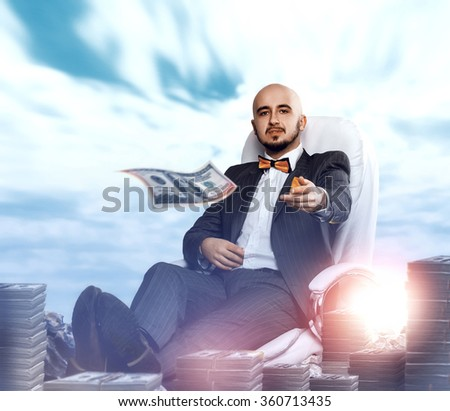 posh rich man throws money away. Business concept - stock photo
