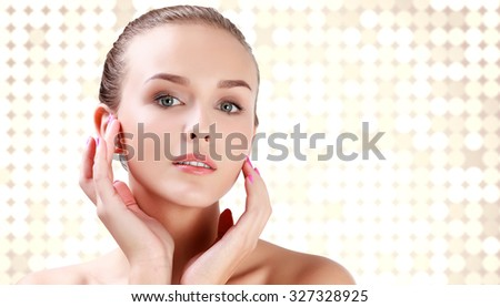 Posh woman against an abstract background with brights round spots - stock photo