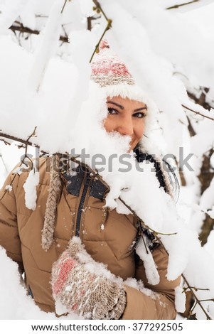 Posing casual woman in park with snow - stock photo
