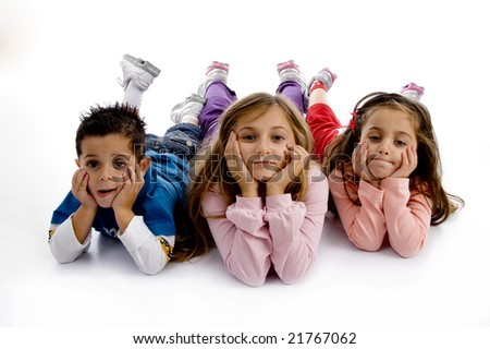 posing cute little siblings looking at camera on an isolated background - stock photo