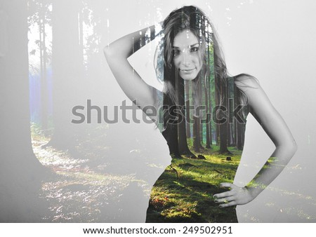 Posing girl in double exposure with green coniferous forrest - stock photo