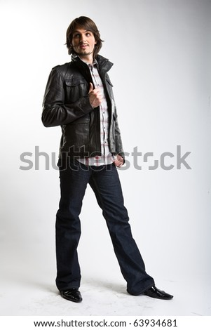 posing man in black jacket - stock photo