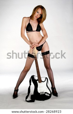 posing with guitar in Studio