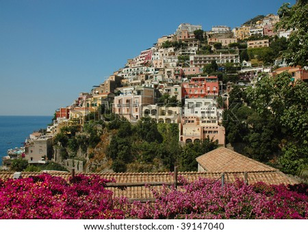 Positano on the Amalfi coast of Italy, with Bougainvilleas in the foreground - stock photo