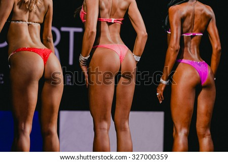 position from back girls fitness bikini. beautiful buttocks in slim swimsuit bikini