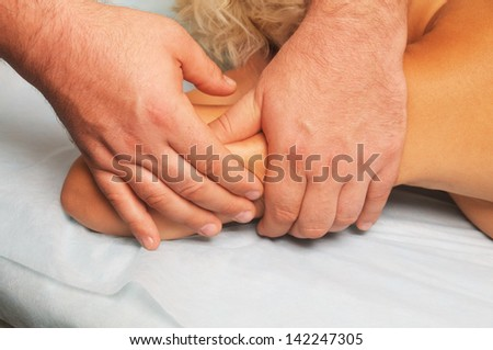 position of hands and fingers at massage of a female body