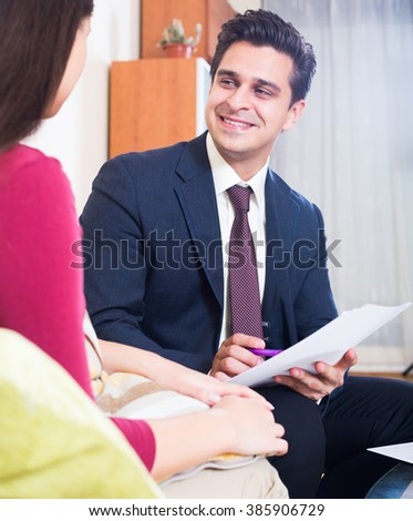 Positive agent explaining customer mortgage agreement at home - stock photo