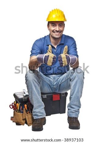 positive and confident young caucasian handyman sit on toolbox - stock photo