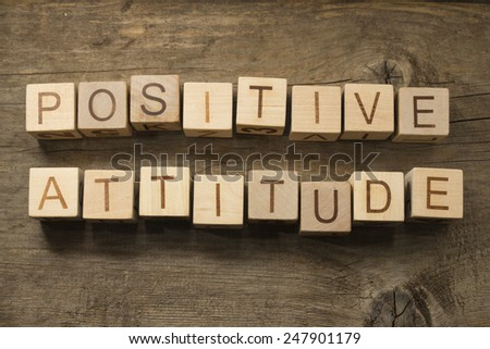 Positive Attitude wooden cubes on a wooden background - stock photo