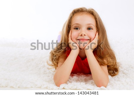 Positive beautiful girl on a white background - stock photo