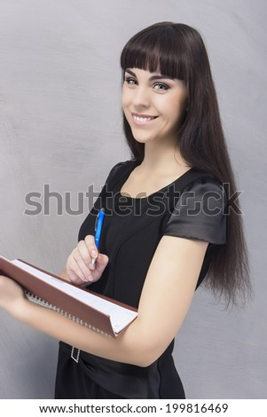 Positive Brunette Woman With Personal Organizer. Vertical Image