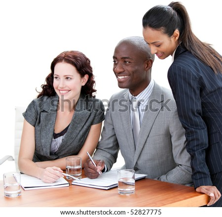 Positive business co-workers studying a document in a meeting