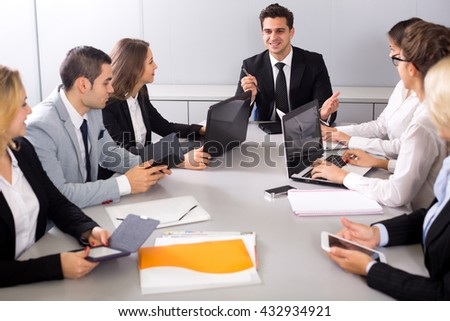 Positive business members of the multinational meetings in office. Focus on the man - stock photo