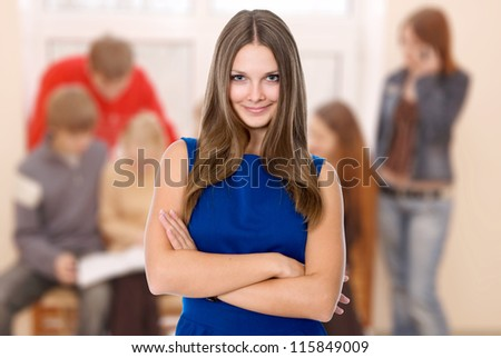 Positive business woman smiling over business background - stock photo