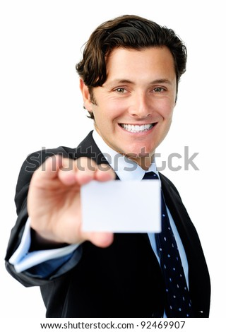 Positive businessman holding a blank card suitable for your company's contact details - stock photo