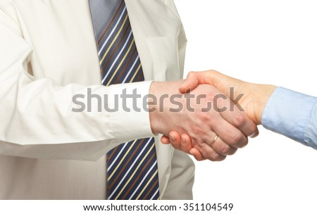 Positive businessman shakes hand of business partner - stock photo