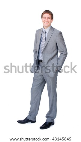 Positive businessman standing with hands in pockets isolated on a white background