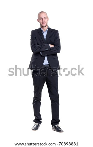 positive businessman with arms crossed - stock photo
