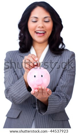 Positive businesswoman saving money in a piggy-bank against a white background - stock photo