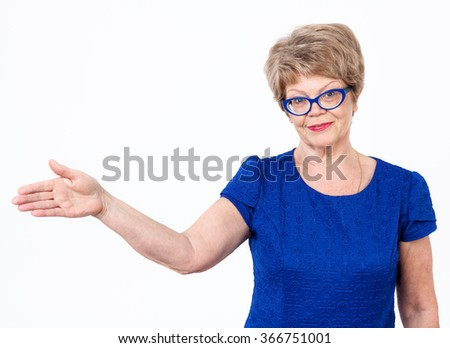 Positive Caucasian woman gesturing with hand to copyspace, white background - stock photo