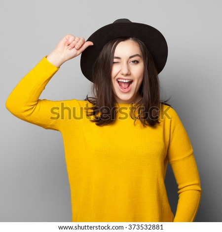 Positive cheerful young teen girl giving a wink to the camera isolated on white. Lifestyle carefree concept. - stock photo