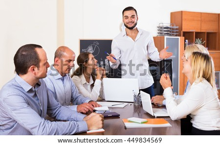 Positive colleagues discussing a price development at the office  - stock photo