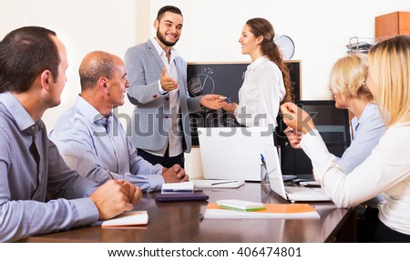 Positive colleagues discussing the price development at the office  - stock photo