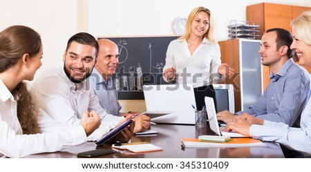 Positive colleagues discussing the price development in the office  - stock photo