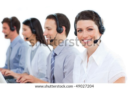 Positive customer service agents working in a call center against a white background
