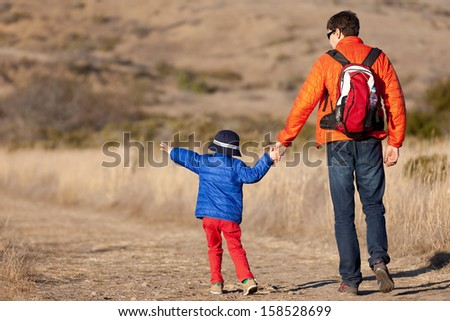 positive family of two hiking together - stock photo
