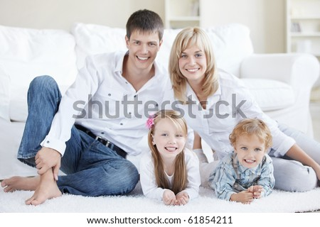 Positive family with children at home - stock photo