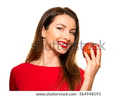 Positive Female Biting a Big Red Apple Fruit Smiling on White Looking at Camera - stock photo