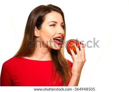 Positive Female Biting a Big Red Apple Fruit Smiling on White Looking Away - stock photo